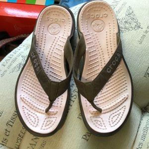 Crocs pink and brown flip flops size 9
